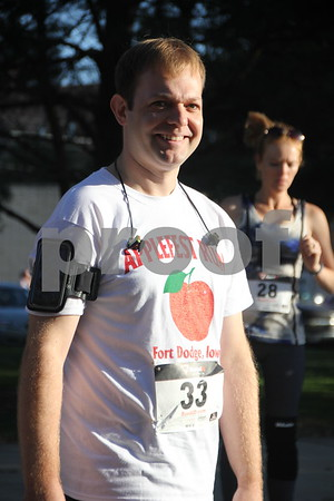 The annual  Applefest 5k/10k run kicked off at the Fort Dodge town square on Sunday, September 27, 2015. Jesse Beekman is  pictured here, before the run  started, preparing to taking part in the event.