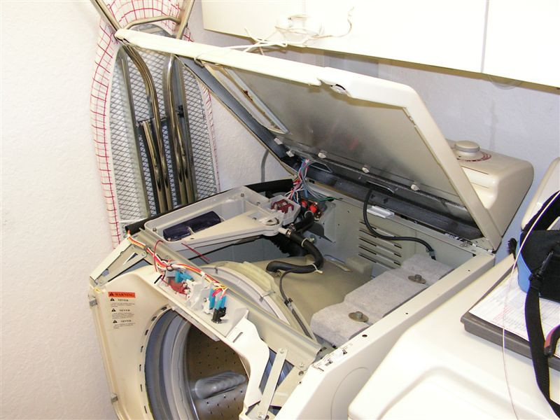 Maytag Neptune Washer with Top Panel Raised, Accessing the Door Latch Assembly