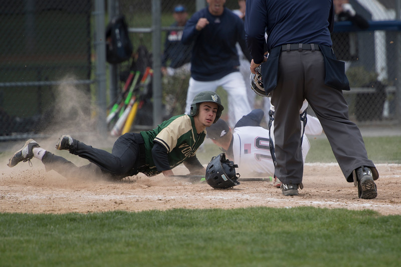 Dylan Sheedy gets the tag at home to prevent more damage during a GNBVT exter inning rally.