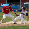 Brady Ouellette slides safely into third after a passed ball by ORR's catcher.