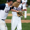 Winning pitcher Mitch Bumpus gets congratulated by Brady Ouellette after his complete game win.