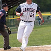 After getting a two RBI single Kaiden Swainamer scores during a four run fourth inning for the Lakers.