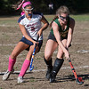Lily Gendron battles for ball control with Bishop Feehan's Allison Saunders.