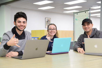 Carlos Vela(left), Kaitlin Huerta and Noe Anguiano are studying at the Mary and Jeff Bell Library.