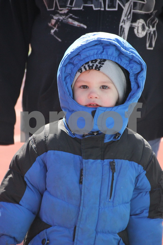 Saturday, April 2, 2016 Dodger Stadium in Fort Dodge was the site of the Moose Lodge Annual Easter Egg Hunt. The event had been scheduled for the previous weekend but had to be rescheduled for this weekend due to weather concerns. Seen bundled up to stay warm in the frigid  temperature is: Tymothy Jennings, who was taking part in the hunt.