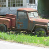 Old Willy's Jeep just kind of rusting into oblivion on the side of the road in KY.  I wish I could drag shit like this home with me and restore it.  This is the history of America, back when America was something.