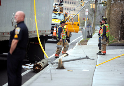 4/1/2016 Mike Orazzi | Staff Emergency crews on South Street at the intersection with Union Street after a semi-trailer truck took out a utility pole Friday morning.