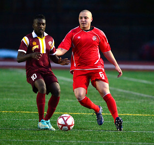 4/2/2016 Mike Orazzi | Staff Connecticut United FC's Edward Floyd (6) and Philadelphia Fury's Jonathan Makaya (10) during Saturday night's soccer match in Willow Brook Park.