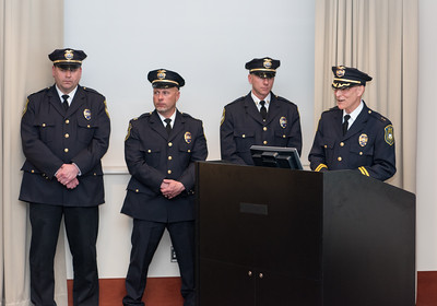 040116   Wesley Bunnell | Staff  New Britain Police honored its own along with two civilians during a presentation at police headquarters Thursday night.  Police standing from L Captain Christopher Chute of Professional Standards, Captain William Steck of the Patrol Division, Captain Thomas Steck of the Investigative Division and Chief of Police James Wardwell at the podium.