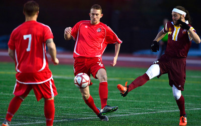 4/2/2016 Mike Orazzi | Staff Connecticut United FC's Connor Archambault (2) and Philadelphia Fury's Nick Morris (18) during Saturday night's soccer match in Willow Brook Park.