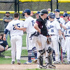 Apr. 29, 2017. Swampscott Middle School, Swampscott. Lynn English vs. Swampscott high school baseball.<br /> The Swampscott dugout emptied to greet Dylan January, far left, after he hit a home run.