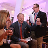 Hank Morse share laughs as Kathy and Ted Truscott bids and wins four  tickets to see Lady Gaga at Fenway Park during the The Northeast Arc's annual Evening of Changing Lives, Saturday, April 29, at Danversport Yacht Club. [Photo / Nicole Goodhue Boyd]