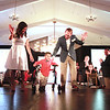 Noah Holt walks with his dad Mitch and mom Elisa in the fashion show during the The Northeast Arc's annual Evening of Changing Lives, Saturday, April 29, at Danversport Yacht Club. Holt was paralyzed from waist down at 6 months of age and is a graduate of ARC Early Intervention Program.  [Photo / Nicole Goodhue Boyd]