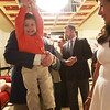 Noah Holt is lifted in the air by his dad Mitch as his mom Elisa looks on as they wait for the fashion show to begin during the The Northeast Arc's annual Evening of Changing Lives, Saturday, April 29, at Danversport Yacht Club. [Photo / Nicole Goodhue Boyd]