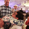 Robert Borsetti of Hamilton  receives a hug from ARC supported Employment participant David McGray  during Evening of Changing Lives, Saturday, April 29, at Danversport Yacht Club. [Photo / Nicole Goodhue Boyd]