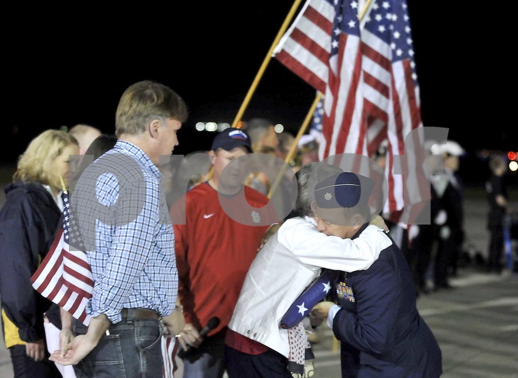 -Messenger photo by Hans Madsen<br /> <br /> Mary Carlson, of Humboldt, gets a hug from Lt. Col. Justin Faiferlick Saturday night after being presented with Flag of Honor that was taken to Washington D.C. on the Brushy Creek Area Honor Flight in honor of her late husband, Air Force Lt. Col. Chuck Carlson. Faiferlick is with the Iowa Air National Guard's 133rd Test Squadron.