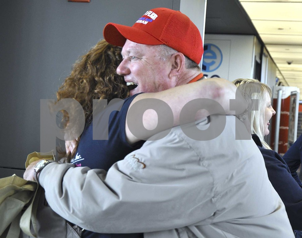 -Messenger photo by Peter Kaspari<br /> <br /> Vietnam War Veteran Robert Chapman smiles as he gets a hug from Caryn Danoff, of northern Virginia, shortly after he got off the plane at Dulles International Airport.