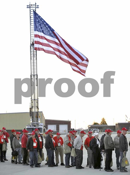 -Messenger photo by Hans Madsen<br /> <br /> The giant U.S. Flag on the Fort Dodge Fire Department's truck waves in the early morning breeze as veterans line up to board the 14th Brushy Creek Area Honor Flight Saturday morning at the Fort Dodge Regional Airport.