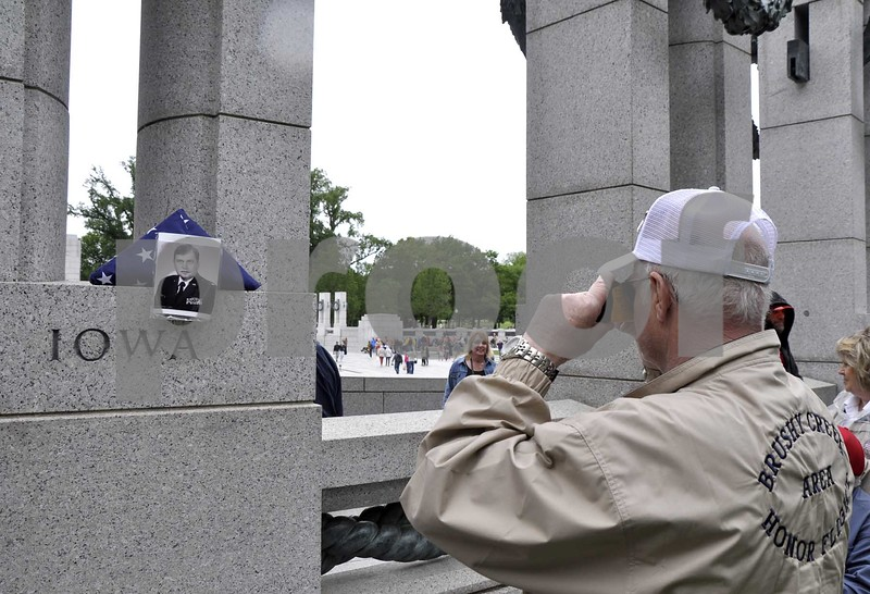 -Messenger photo by Peter Kaspari<br /> <br /> A photo of Air Force Veteran Lt. Col. Charles Carson, of Humboldt, is posed next to a flag at the World War II Memorial during the Brushy Creek Area Honor Flight. Carson was one of four Flags of Honor during the flight, which meant he had been selected to go on the flight, but died before he could go.