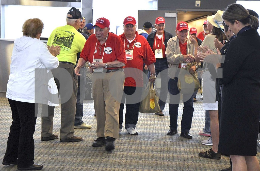 -Messenger photo by Peter Kaspari<br /> <br /> The veterans on the Brushy Creek Area Honor Flight are greeted as they exit the terminal at Dulles International Airport in Washington, D.C.
