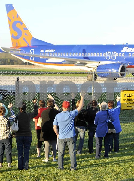 -Messenger photo by Hans Madsen<br /> <br /> Well wishers, family members and friends wave goodbye to the veterans going on the 14th Brushy Creek Area Honor Flight Saturday morning at the Fort Dodge Regional Airport.