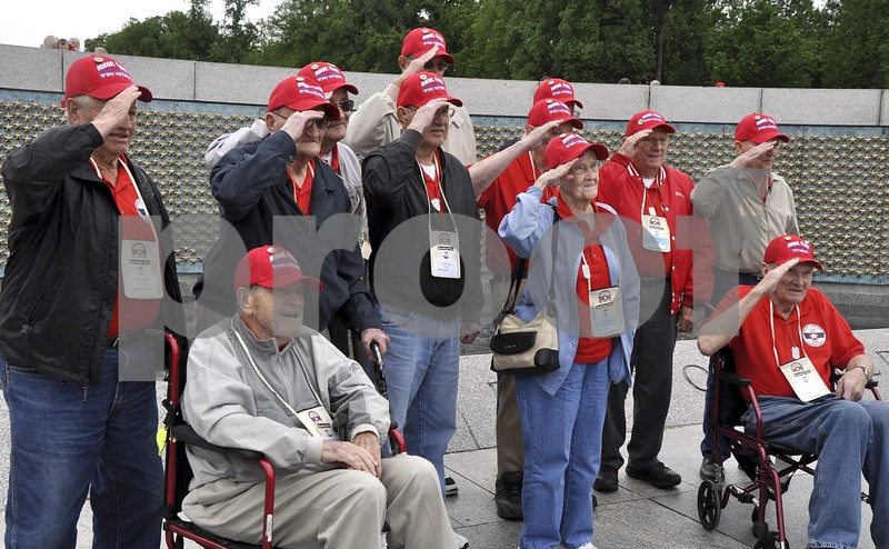 -Messenger photo by Peter Kaspari<br /> <br /> The World War II veterans on the Brushy Creek Area Honor Flight salute during a photo at the World War II Memorial in Washington, D.C.