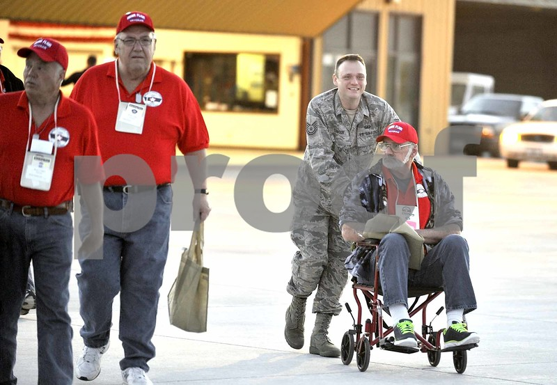 -Messenger photo by Hans Madsen<br /> <br /> Army Vietnam War veteran Carter Fetters, of Jefferson, gets a push to the airplane from Tech Sgt. James Dawson, with the 133rd Test Squadron, as veterans board the Brushy Creek Area Honor Flight Saturday morning at the Fort Dodge Regional Airport.