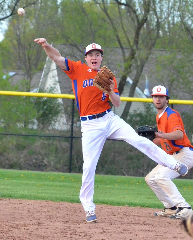 . KYLE MENNIG - ONEIDA DAILY DISPATCH Oneida\'s Henry Froass (6) makes a jumping throw to try and retire a Cortland batter at first during their game in Oneida on Friday, April 28, 2017.