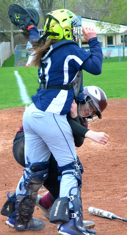 . KYLE MENNIG - ONEIDA DAILY DISPATCH Central Valley Academy\'s Sianna Kenyon (9) catches the ball at the plate before tagging out a Canastota runner during their game in Canastota on Tuesday, April 25, 2017.