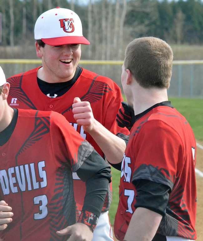 . KYLE MENNIG � ONEIDA DAILY DISPATCH Vernon-Verona-Sherrill\'s Andrew Roden (18) congratulates teammate Zach Nell (7) after Nell\'s home run against Oneida during their game in Verona on Thursday, April 13, 2017.
