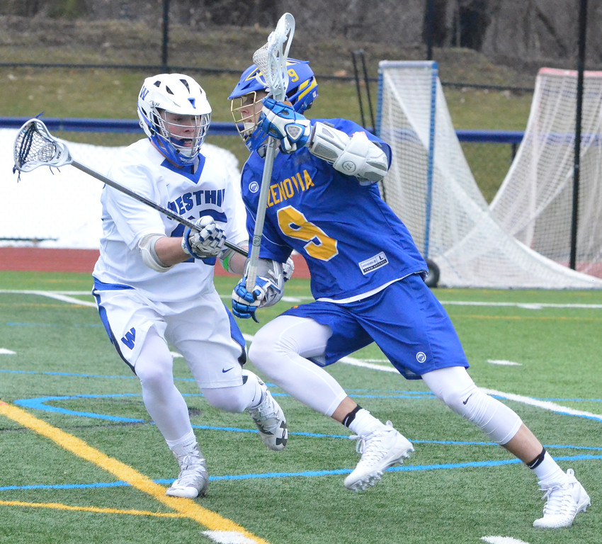 . KYLE MENNIG - ONEIDA DAILY DISPATCH Cazenovia\'s Thomas Bragg (9) looks to attack as Westhill\'s Jack Gilmartin (25) defends during their game in Syracuse on Saturday, April 1, 2017.