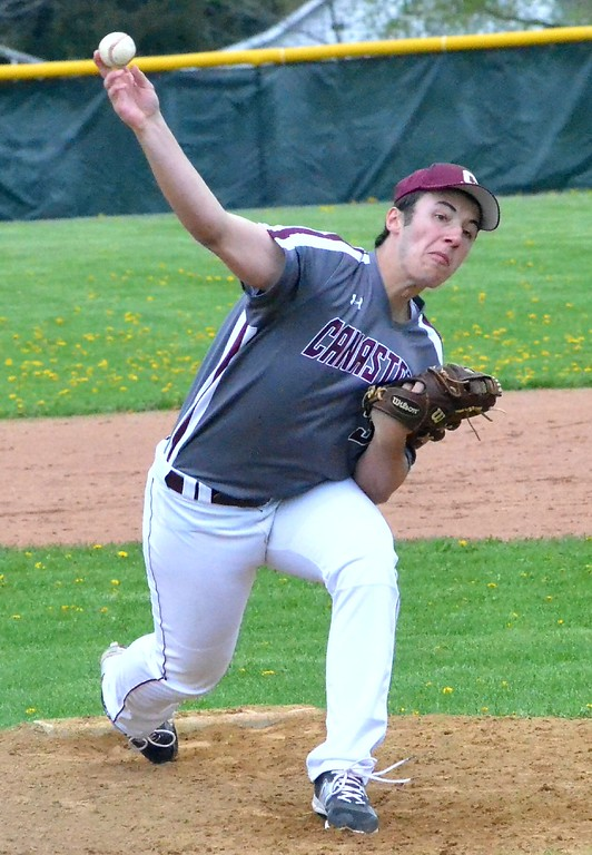 . KYLE MENNIG - ONEIDA DAILY DISPATCH Canastota\'s Sam DiGeorge (3) delivers a pitch to a Chittenango batter during their game in Chittenango on Saturday, April 29, 2017.