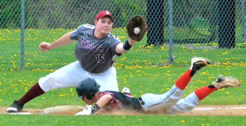 . KYLE MENNIG - ONEIDA DAILY DISPATCH Chittenango\'s Tom Rooney (3) dives safely into third for a stolen base as Canastota\'s John Sadowski (16) fields the throw during their game in Chittenango on Saturday, April 29, 2017.