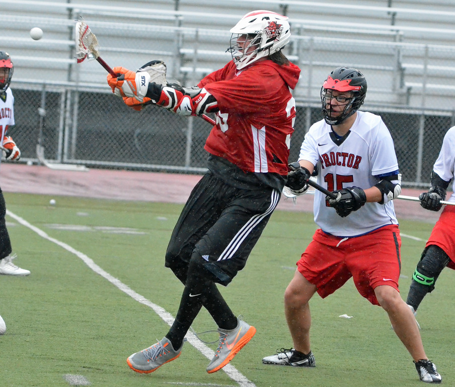 . KYLE MENNIG - ONEIDA DAILY DISPATCH Vernon-Verona-Sherrill\'s Richard Geiss (39) makes a pass in front of Proctor\'s Ronaldo Alesandro (15) during their game in Utica on Thursday, April 6, 2017.