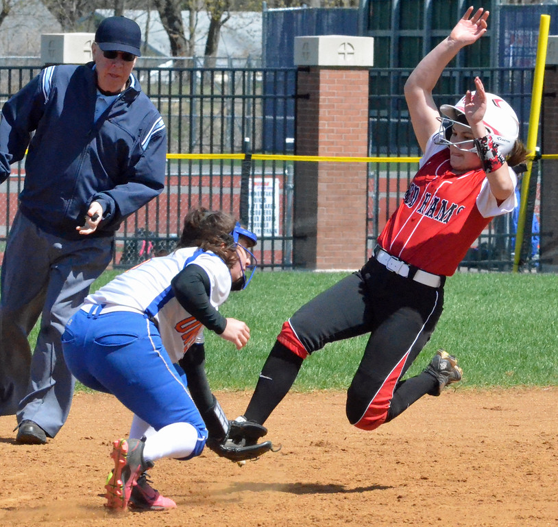 . KYLE MENNIG � ONEIDA DAILY DISPATCH Jamesville-DeWitt\'s Makenzie Keeler, right, goes to slide into second for a stolen base as the ball gets away from Oneida\'s Brianna Laureti during their game in Oneida on Monday, April 17, 2017. Skibitski was called out on the play.