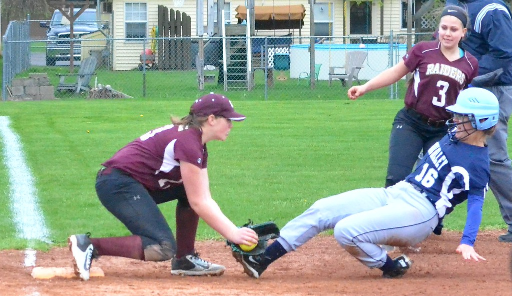 . KYLE MENNIG - ONEIDA DAILY DISPATCH Canastota\'s Jessica Evans (13) tags Central Valley Academy\'s Allyson Nelms (16) out at third during their game in Canastota on Tuesday, April 25, 2017.