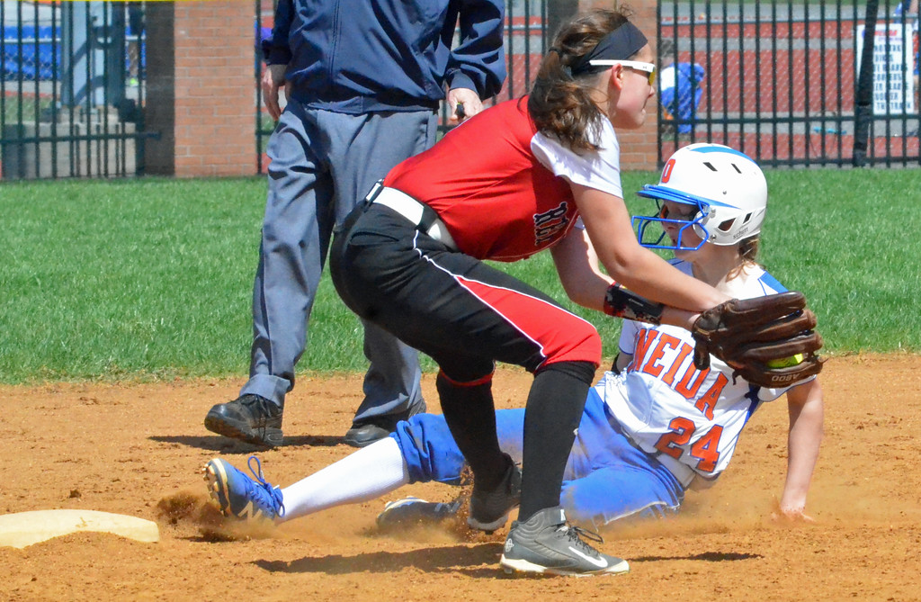 . KYLE MENNIG � ONEIDA DAILY DISPATCH Oneida\'s Lauren Skibitski (1) slides into second for a stolen base as Jamesville-DeWitt\'s Makenzie Keeler (9) fields the throw during their game in Oneida on Monday, April 17, 2017.