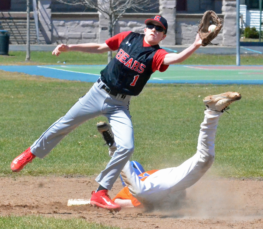 . KYLE MENNIG - ONEIDA DAILY DISPATCH Oneida\'s James Dick (24) slides safely into second for a stolen base as Chittenango\'s Noah Schnauffer (1) fields the throw during their game in Rome on Sunday, April 9, 2017.