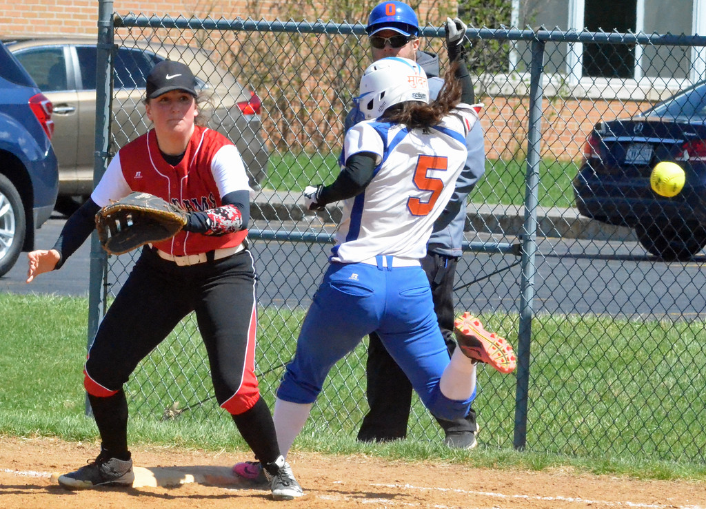 . KYLE MENNIG � ONEIDA DAILY DISPATCH Oneida\'s Brianna Laureti (5) safely reaches first against Jamesville-DeWitt during their game in Oneida on Monday, April 17, 2017. Skibitski was called out on the play.