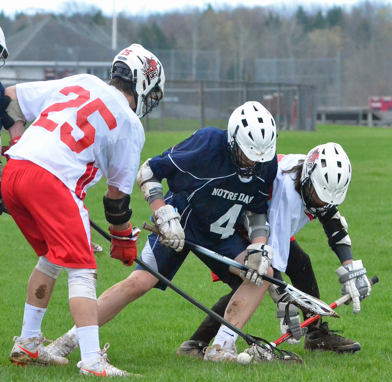 . KYLE MENNIG � ONEIDA DAILY DISPATCH Vernon-Verona-Sherrill\'s Jon Lubeck (27) and Sean Galla and Utica Notre Dame\'s Logan Chimento (4) try to scoop up a loose ball during their game in Verona on Saturday, April 22, 2017.