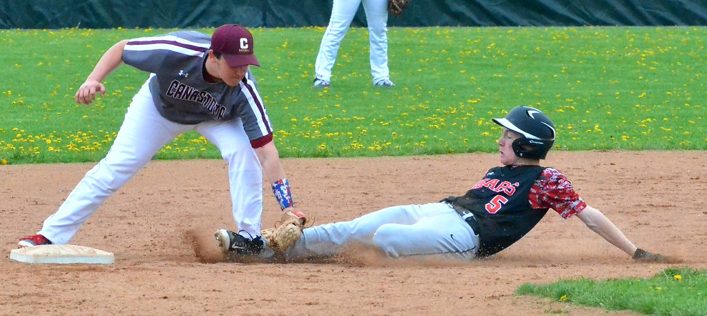 . KYLE MENNIG - ONEIDA DAILY DISPATCH Canastota\'s Joe Russo (2) tags Chittenango\'s Zachary Jasmin (5) out trying to steal second during their game in Chittenango on Saturday, April 29, 2017.