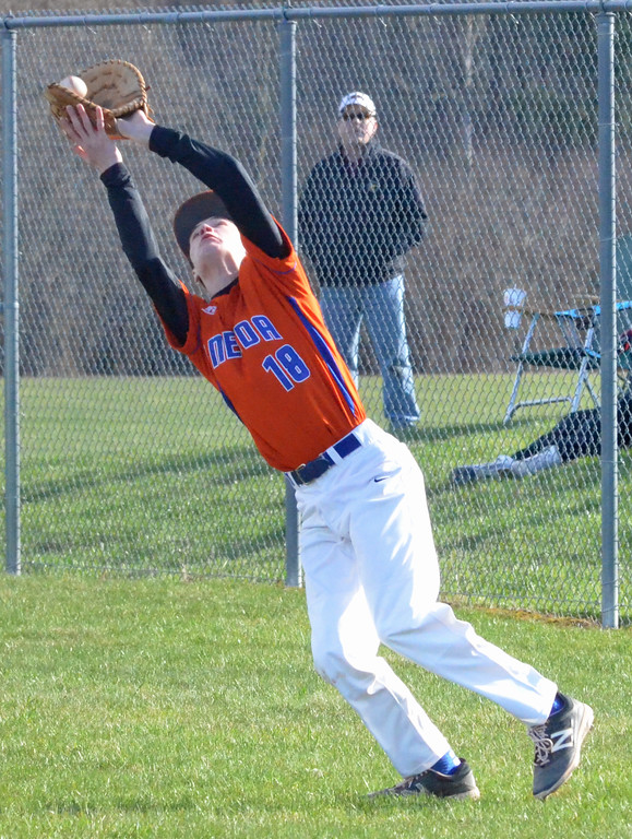 . KYLE MENNIG � ONEIDA DAILY DISPATCH Oneida\'s Dan Myatt (18) reaches back to make a catch in foul territory and retire a Vernon-Verona-Sherrill batter during their game in Verona on Thursday, April 13, 2017.