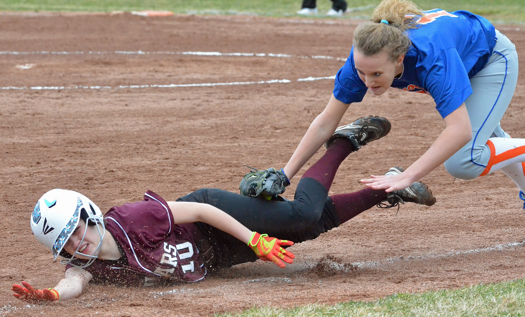 . KYLE MENNIG - ONEIDA DAILY DISPATCH Stockbridge Valley\'s Kendra Webb (10 is tagged out trying to get back to third by Brookfield\'s Madilyne Kupris (12) during their game in Munnsville on Wednesday, April 5, 2017.
