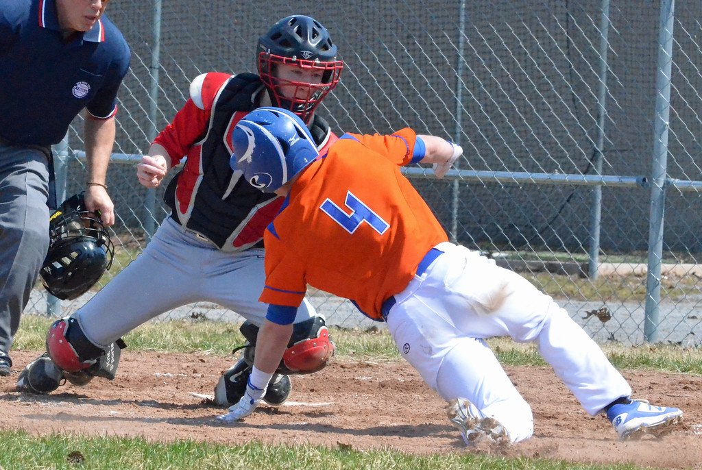 . KYLE MENNIG - ONEIDA DAILY DISPATCH Oneida\'s Lukas Albro (4) slides into home where he is tagged out by Chittenango catcher Zachary Jasmin during their game in Rome on Sunday, April 9, 2017.