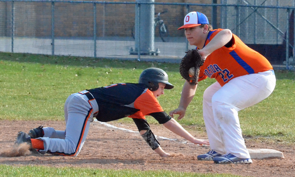 . KYLE MENNIG � ONEIDA DAILY DISPATCH Rome Free Academy\'s Josh Wood (5) dives back into first under the tag of Oneida\'s Ryan Chevier (22) during their game in Rome on Sunday, April 9, 2017.