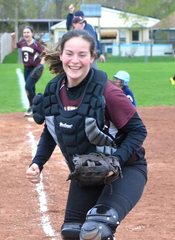 . KYLE MENNIG - ONEIDA DAILY DISPATCH Canastota catcher Jade Shimer and teammate Brianna Johnson (3) celebrate after retiring a Central Valley Academy player at third during their game in Canastota on Tuesday, April 25, 2017.