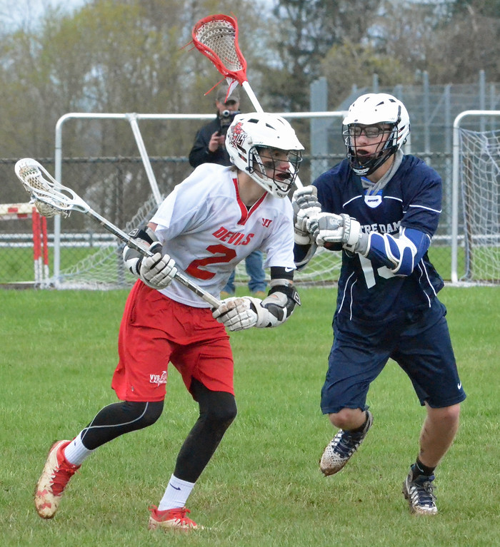 . KYLE MENNIG � ONEIDA DAILY DISPATCH Vernon-Verona-Sherrill\'s Brayden Marchand (2) brings the ball up the field as Utica Notre Dame\'s Nate Cooley (13) defends during their game in Verona on Saturday, April 22, 2017.