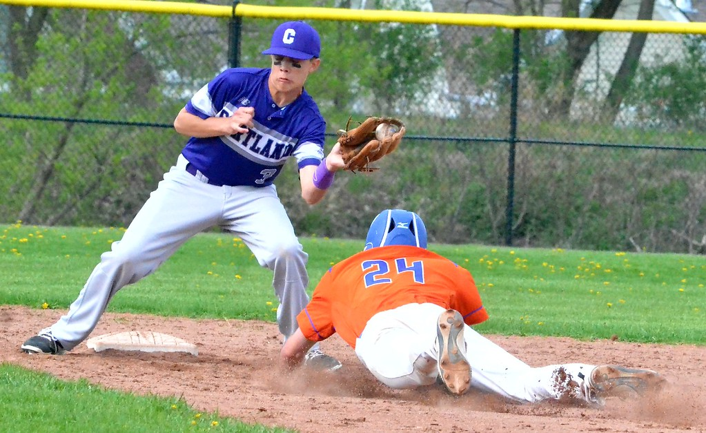 . KYLE MENNIG - ONEIDA DAILY DISPATCH Oneida\'s James Dick (24) dives safely into second for a stolen base as Cortland\'s Cameron Woodward (3) fields the throw during their game in Oneida on Friday, April 28, 2017.