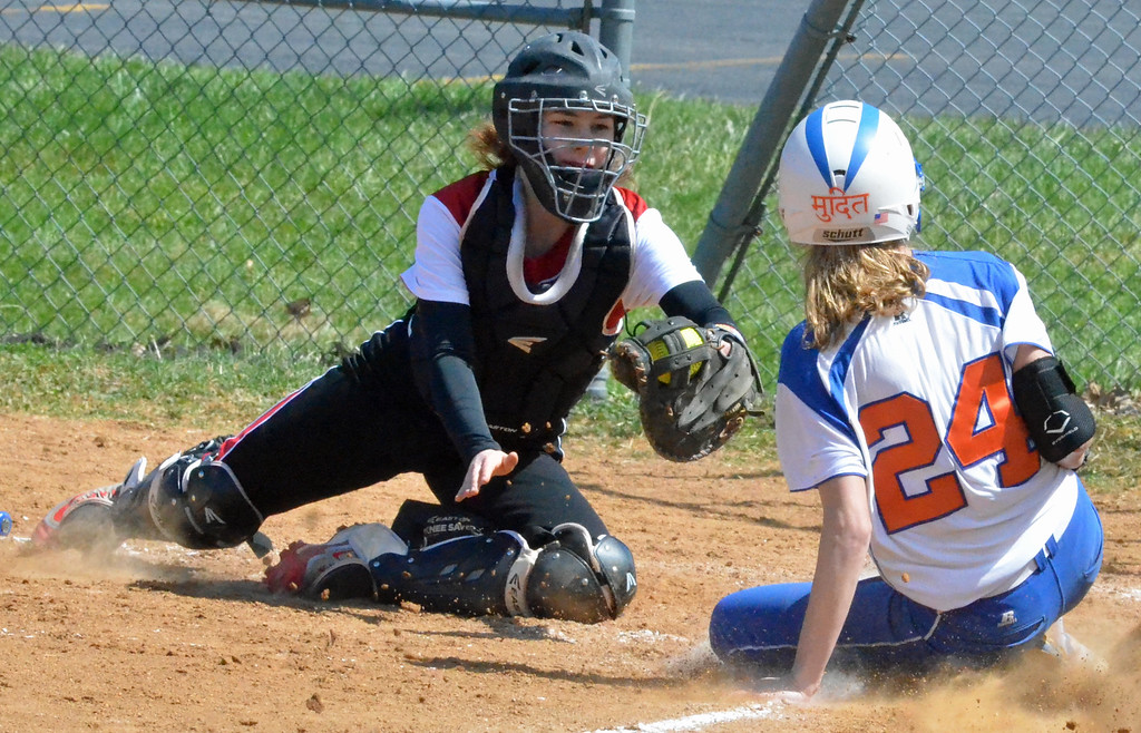. KYLE MENNIG � ONEIDA DAILY DISPATCH Oneida\'s Lauren Skibitski (24) slides into home as Jamesville-DeWitt catcher Sara Gow makes the tag during their game in Oneida on Monday, April 17, 2017. Skibitski was called out on the play.