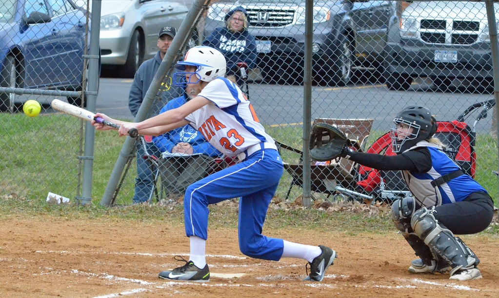 . KYLE MENNIG � ONEIDA DAILY DISPATCH Oneida\'s Sydney Lusher (23) lays down a bunt in front of Camden catcher Lily Sullivan during their game in Oneida on Wednesday, April 12, 2017.